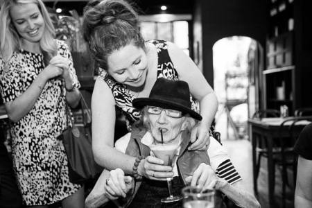 Maggie sips a Lady Diaz with Kristy watching on... By Trudy Schuringa © 2014